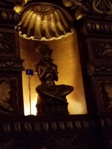 Indian god along the side inside the theatre